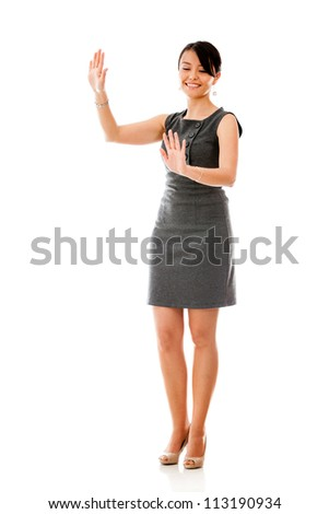 Businesswoman moving imaginary objects - isolated over a white background