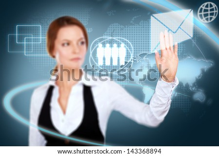 Businesswoman  navigating futuristic interface - stock photo