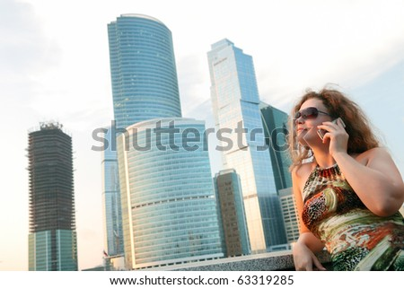 Businesswoman near modern buildings (moscow)