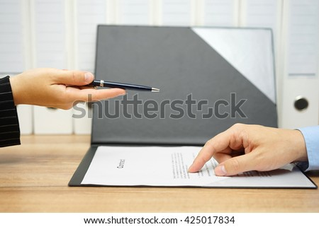 businesswoman offer a pen over a contract to client - stock photo