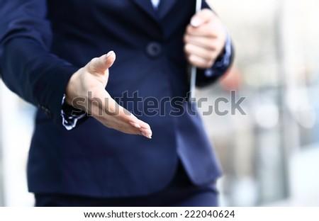 Businesswoman offer hand to handshake - stock photo
