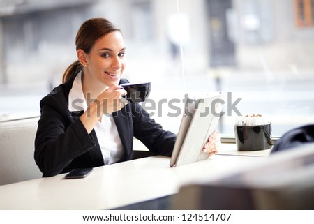 Businesswoman on a coffee break, using tablet computer