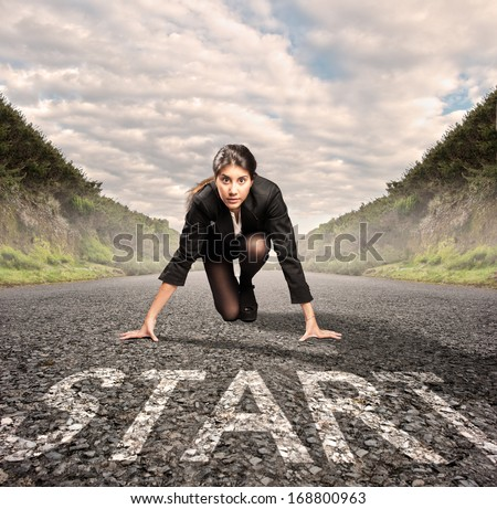 businesswoman on a road ready to run. Motivation concept