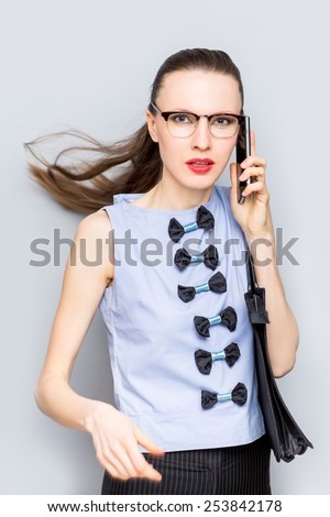 Businesswoman on cellphone running while talking on smart phone. Happy smiling caucasian business woman busy. motion - stock photo