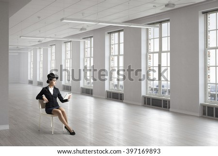 Businesswoman on chair in office
