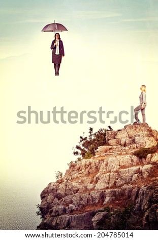 businesswoman on cliff abstract background - stock photo