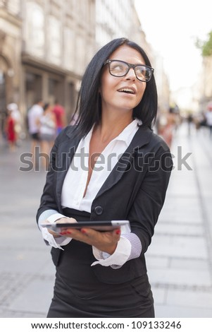 Businesswoman on street with tablet computer, Business woman