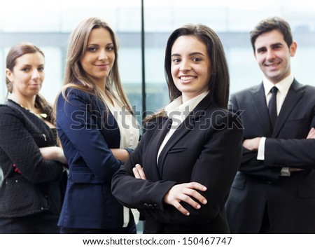 Businesswoman on the foreground of his collegues