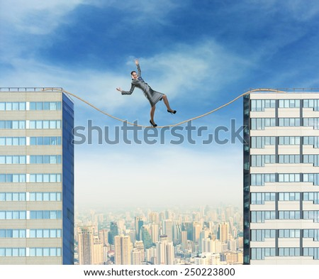Businesswoman on the rope  - stock photo