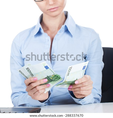 Businesswoman on workplace with euros in hands  - stock photo