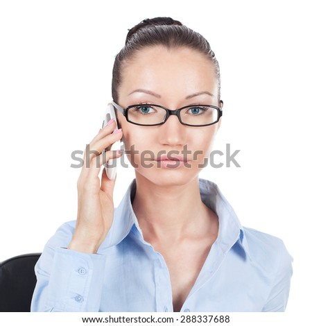 Businesswoman on workplace with phone in hand  - stock photo