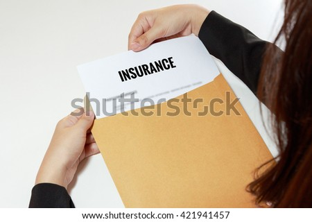 Businesswoman opening Insurance document in letter envelope concept