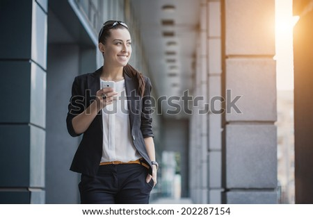 businesswoman or entrepreneur talking on cellphone. City businesswoman working. - stock photo