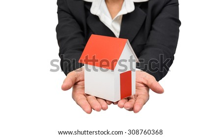 Businesswoman or estate agent and holding a model house.  isolated on white background with clipping path - stock photo