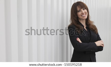 Businesswoman outside office building - stock photo