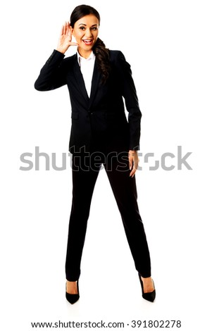 Businesswoman overhears someone - stock photo