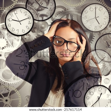 Businesswoman overload appointments and with little time - stock photo
