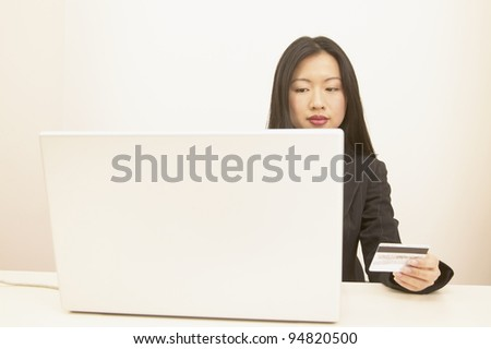 Businesswoman paying online - stock photo