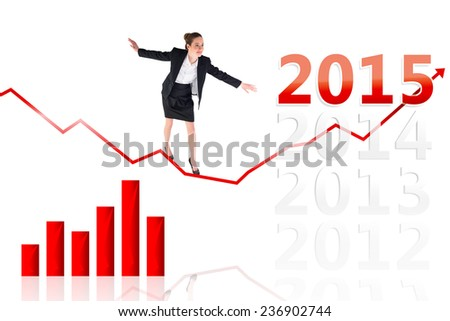 Businesswoman performing a balancing act against 2015