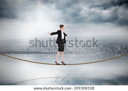 Businesswoman performing a balancing act on tightrope against room with large window looking on city - stock photo