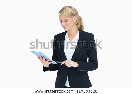 Businesswoman planning and touching on her tablet