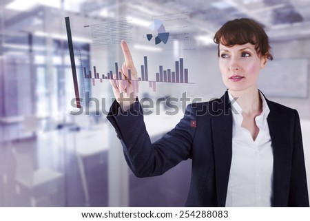 Businesswoman pointing against classroom