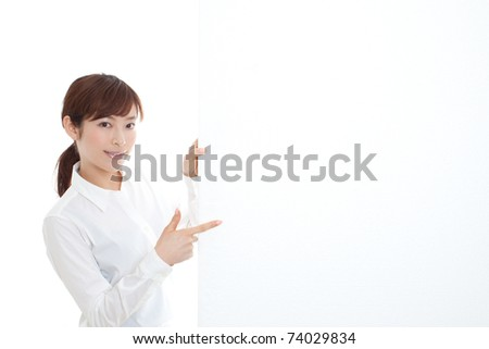 Businesswoman pointing at a blank board