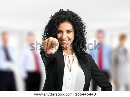 Businesswoman pointing her finger at you - stock photo