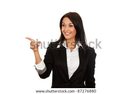 Businesswoman pointing her finger on empty copy space, isolated over white background