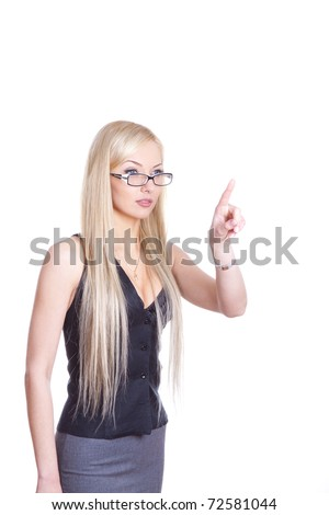 Businesswoman pointing her finger on imagined virtual button. - stock photo
