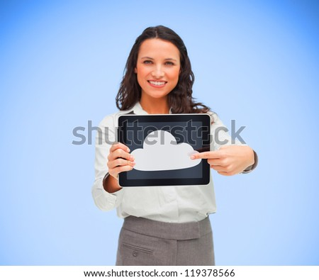 Businesswoman pointing to cloud computing symbol on tablet pc and smiling