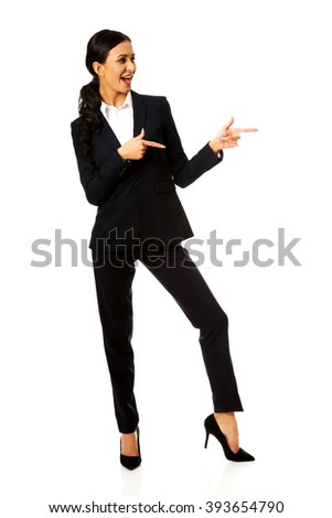 Businesswoman pointing to the left - stock photo