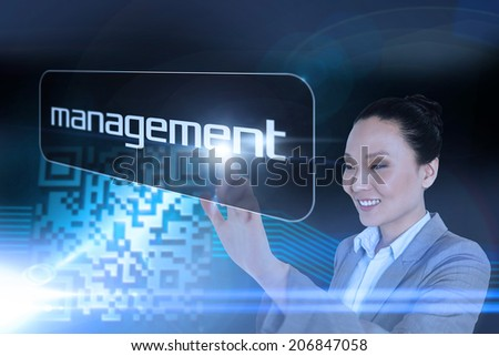Businesswoman pointing to word management against shiny barcode on black background - stock photo