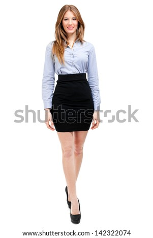 Businesswoman portrait full length walking