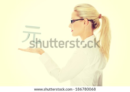 Businesswoman presenting China currency denominations over white - stock photo