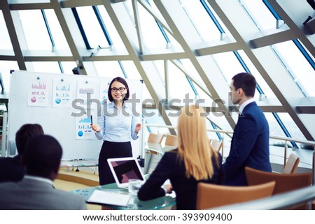 Businesswoman presenting her ideas to business partners - stock photo