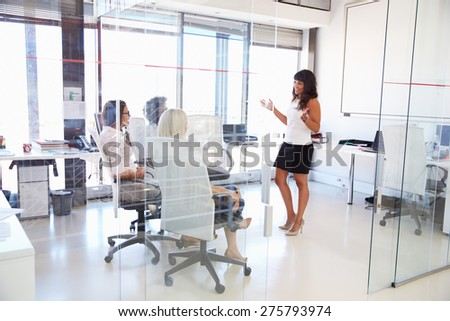 Businesswoman presenting meeting in an office - stock photo