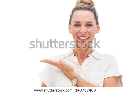 Businesswoman presenting something with palm on the left
