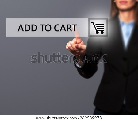 Businesswoman pressing add to cart button on virtual screens.Women finger on cart icon. Isolated on grey. Business, technology, internet and networking concept - Stock Image