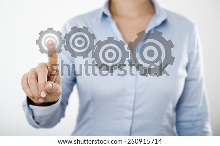 businesswoman pressing button on the digital touch screen  - stock photo