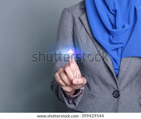 Businesswoman pressing button with contact on virtual screens