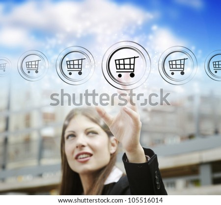 Businesswoman pressing cart button, symbol of modern online marketing and shopping - stock photo