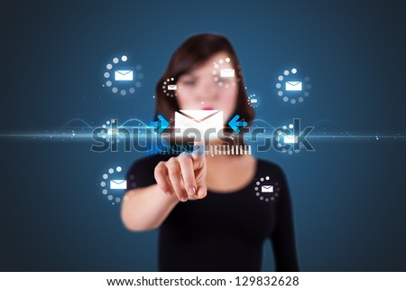 Businesswoman pressing messaging type of modern icons with virtual background - stock photo