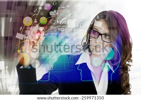 Businesswoman pressing modern buttons on a virtual background - stock photo