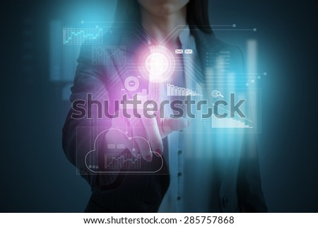 businesswoman pressing on cloud computing on virtual screen over dark background - stock photo