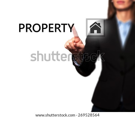 Businesswoman pressing property button on virtual screens. Women finger on home icon. Isolated on white. Business, technology, internet and networking concept - Stock Image