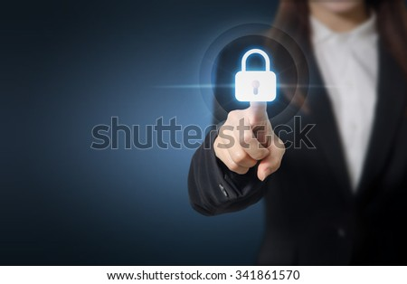 Businesswoman pressing security button on virtual screens, Business concept and technology information security and data encryption. Copy space. - stock photo