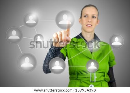 Businesswoman pressing social buttons on virtual screen. Social media concept. - stock photo