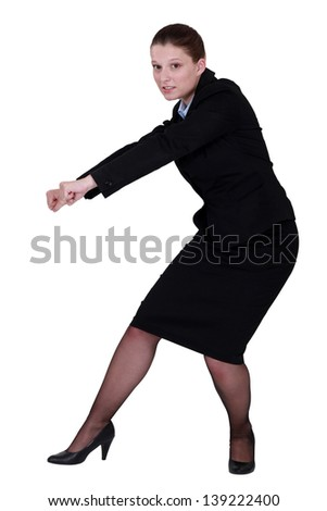 Businesswoman pull action - stock photo