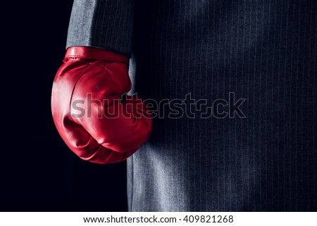 Businesswoman, punch wearing boxing gloves